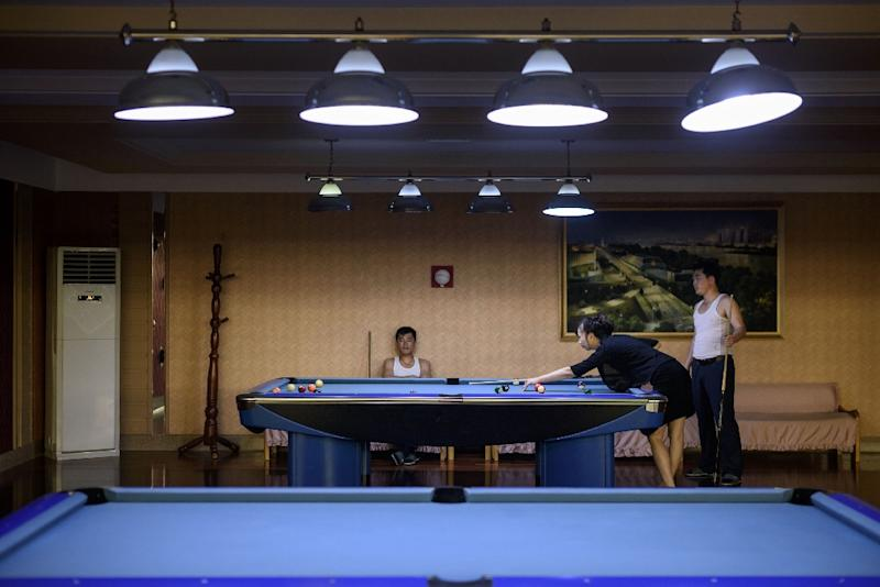 People play pool at a leisure centre in Pyongyang (AFP Photo/Ed JONES)