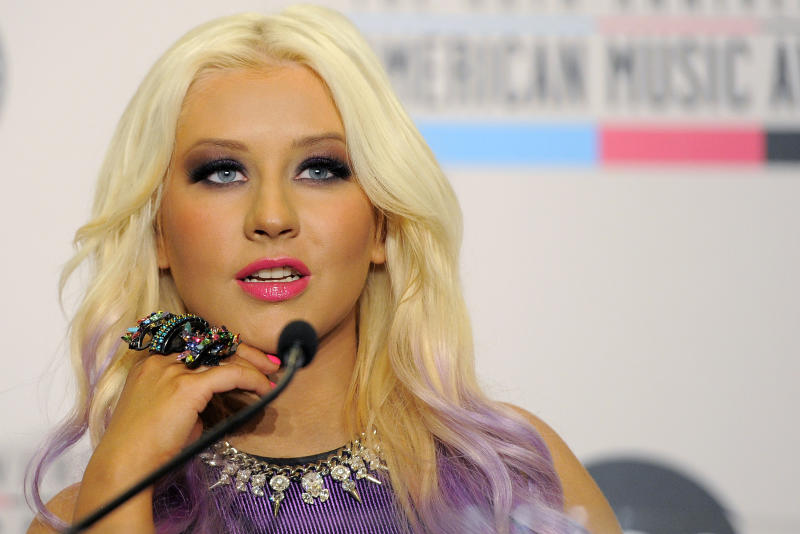 Singer Christina Aguilera announces nominations for the 2012 American Music Awards at the J.W. Marriott L.A. Live on Tuesday, Oct. 9, 2012, in Los Angeles. The 40th Anniversary American Music Awards will be held on November 18 at the Nokia Theatre in Los Angeles. (Photo by Chris Pizzello/Invision/AP)