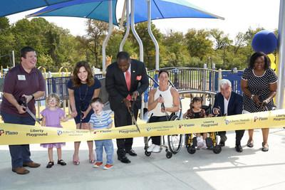 Liberty Playground ribbon cutting (L-R): Dylan Rafaty, Vice Chair, TX Governor's Committee on People with Disabilities; Melissa MacDonnell, Liberty Mutual Foundation President; Mayor Harry LaRosiliere, Mayor, Plano, TX; Tatyana McFadden, U.S. Paralympic medalist; David Long, Liberty Mutual Chairman and CEO; Lola Dada-Olley, Plano, TX City attorney, resident and parent; Joined by children of Plano, TX. (Cooper Neill/Getty Images)