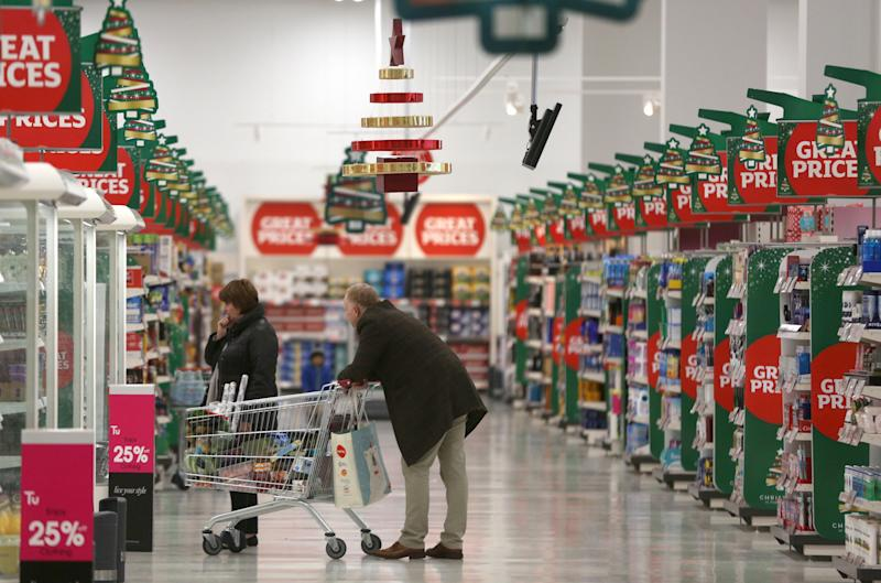 Customers shop at a Sainsbury's store in London, Britain December 3, 2015. Britons will spend 20.3 billion pounds ($31 billion) on groceries over the festive period, a 1.4 percent increase on last year, industry research group IGD forecast on Wednesday. The group said its research found 19 percent of shoppers plan to spend more on food and drink over the Christmas period, defined as Nov. 20 to Dec. 26, than the previous Christmas, a trend which could be positive for the likes of market leaders Tesco and Sainsbury. REUTERS/Neil Hall