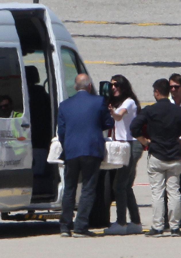 Amal was on hand to pop the other bub in the waiting van. Source: Australscope