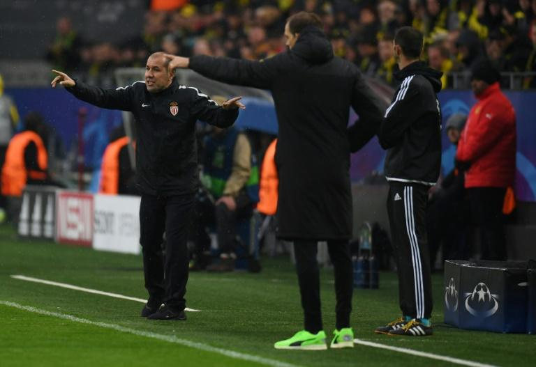 Monaco's head coach Leonardo Jardim (L) and Dortmund's Thomas Tuchel react on the sideline during their UEFA Champions League quarter-final 1st leg match, in Dortmund, on April 12, 2017