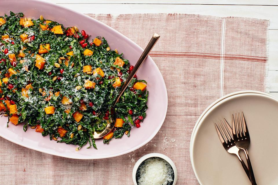 """Roasted garlic adds serious depth to the mustard and maple syrup-spiked vinaigrette. <a href=""""https://www.epicurious.com/recipes/food/views/kale-salad-with-roasted-butternut-squash-pomegranate-and-pumpkin-seeds?mbid=synd_yahoo_rss"""" rel=""""nofollow noopener"""" target=""""_blank"""" data-ylk=""""slk:See recipe."""" class=""""link rapid-noclick-resp"""">See recipe.</a>"""
