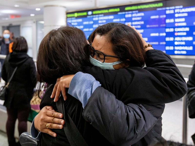 A woman hugs her relative as she arrives in Toronto, Canada, on a flight from Hong Kong shortly after Toronto Public Health received notification of Canada's first presumptive confirmed case of coronavirus, 26 January, 2020: Carlos Osorio/Reuters