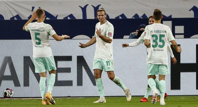 Niclas Fuellkrug (centre) celebrated a hat-trick as Werder Bremen inflicted more misery on Schalke