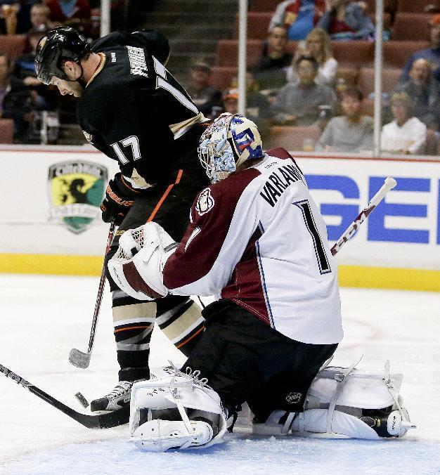 Colorado Avalanche goalie Semyon Varlamov, right, blocks a shot by Anaheim Ducks left wing Dustin Penner during the second period of an NHL preseason hockey game in Anaheim, Calif., Sunday, Sept. 22, 2013. (AP Photo/Chris Carlson)