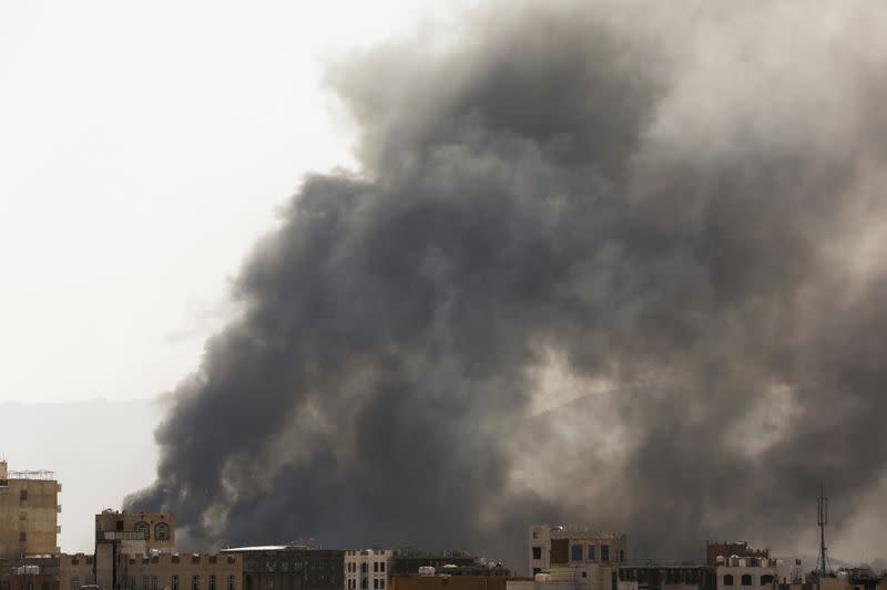 Smoke billows from the site of Saudi-led air strikes in Sanaa, Yemen
