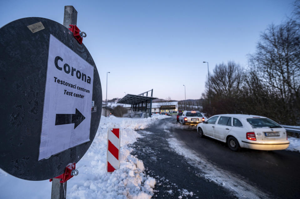Cars queue in front of a Corona test station at the German-Czech Republic border in Furth im Wald, Germany, Monday, Jan. 25, 2021. German police say hundreds of cars and pedestrians are lining up at border crossings along the Czech-German border after Germany declared the Czech Republic a high risk area in the pandemic meaning it requires proof a negative coronavirus test results before entry. (Armin Weigel/dpa via AP)