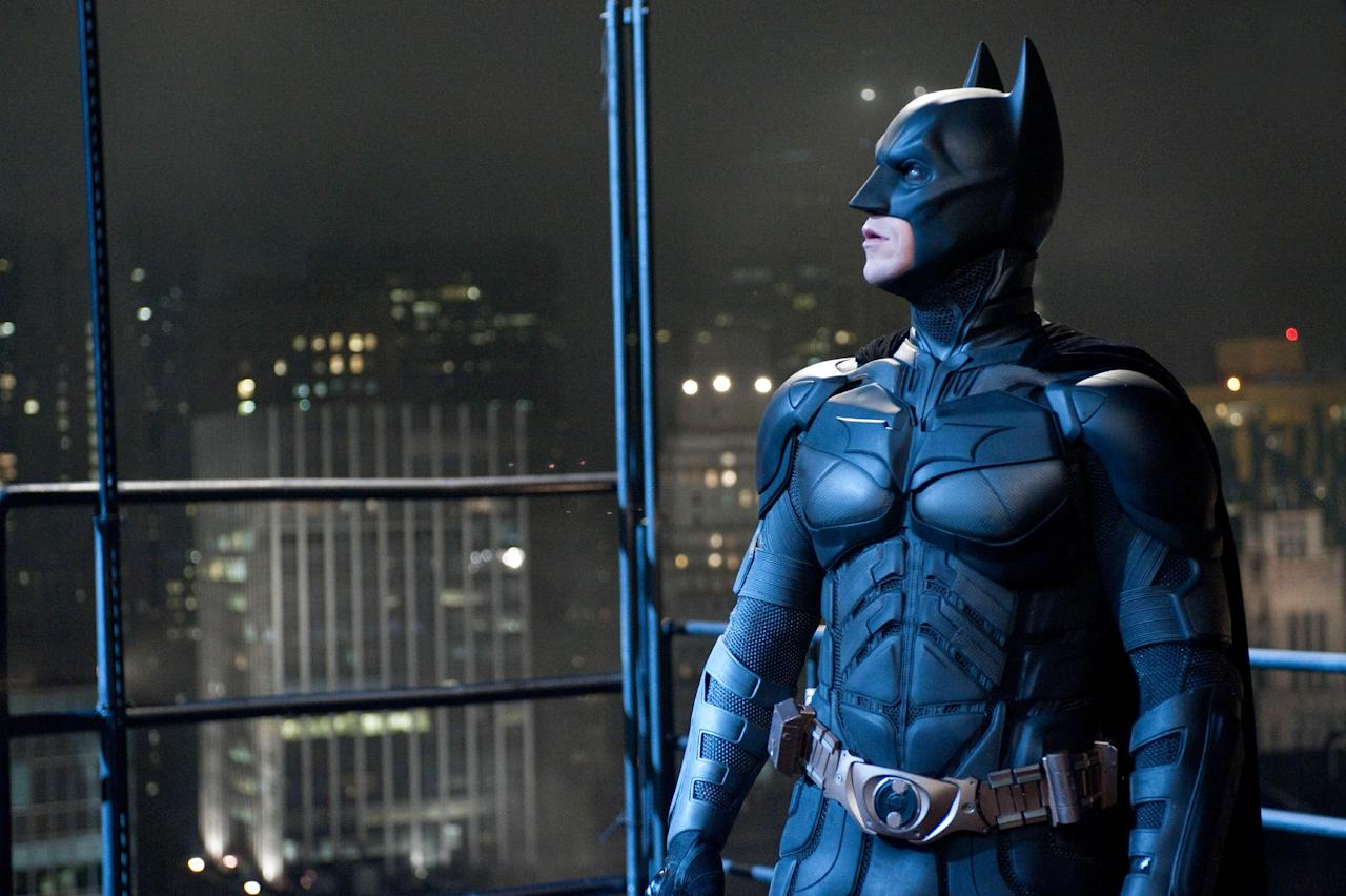 """FILE - In this file film image provided by Warner Bros., Christian Bale portrays Bruce Wayne and Batman in a scene from """"The Dark Knight Rises."""" The Dark Knight Rises"""" stayed atop the box office for the second straight weekend, making just over $64 million. But it's lagging behind the staggering numbers of its predecessor, 2008's """"The Dark Knight."""" (AP PHoto/Warner Bros., File)"""