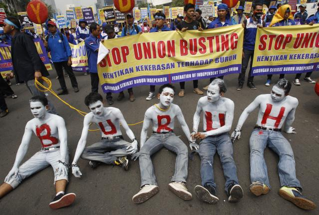 "Indonesian workers with their faces and bodies painted in white and an Indonesian word ""Buruh"" that means ""Workers"" in red take part in a rally commemorating May Day in Jakarta, Indonesia, Wednesday, May 1, 2013. (AP Photo/Achmad Ibrahim)"