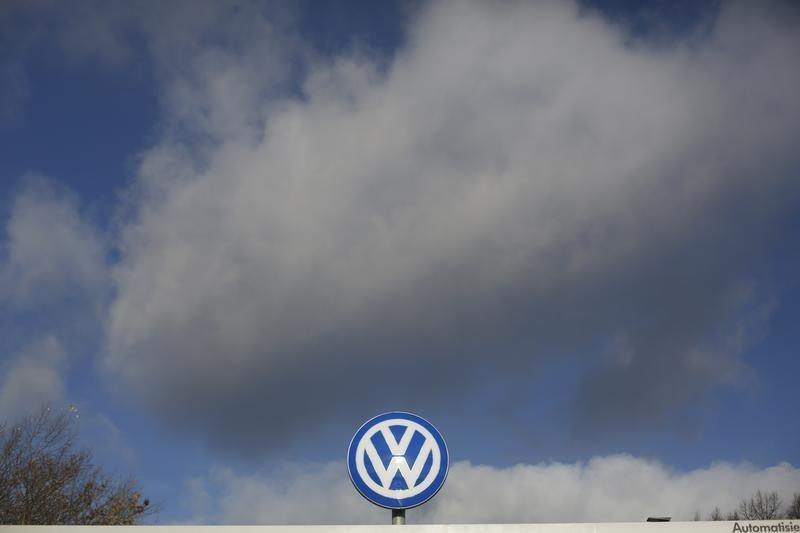 A Volkswagen company logo sits atop the VW factory in Wolfsburg