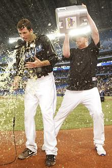 Blue Jays pitcher Brandon Morrow, left, is doused by teammate Jesse Litsch following Morrow's one-hitter