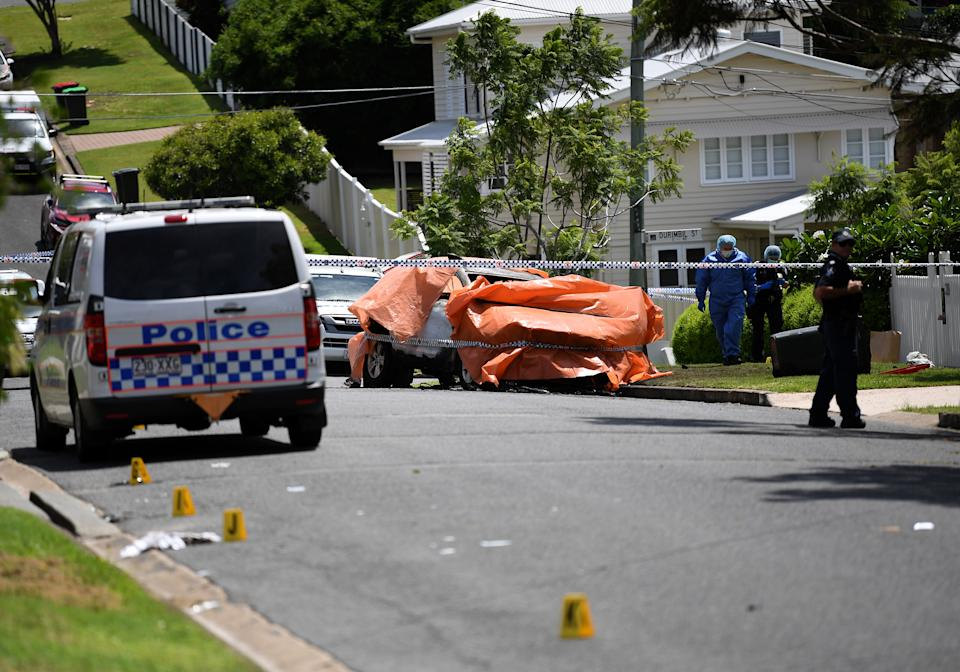 Dozens of emergency services personnel attended the scene at Camp Hill, Brisbane.