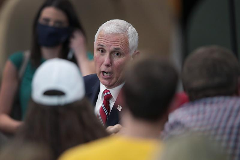 U.S. Vice President Mike Pence greets workers at Tankcraft Corporation on August 19, 2020 in Darien, Wisconsin. The visit comes a day after President Donald Trump's son Eric visited the state and two days after the president visited the state. (Scott Olson/Getty Images)