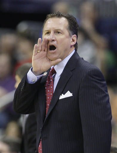 North Carolina State head coach Mark Gottfried shouts during the second half of an NCAA men's college basketball tournament second-round game against San Diego State in Columbus, Ohio, Friday, March 16, 2012. (AP Photo/Tony Dejak)