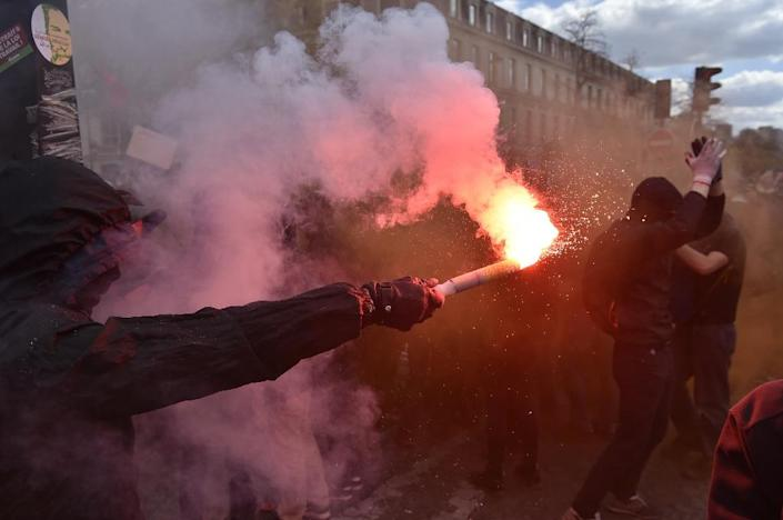 The clashes came as at least 170,000 workers and students took to streets nationwide Thursday in a new push for the withdrawal of the proposed labour law (AFP Photo/Alain Jocard)