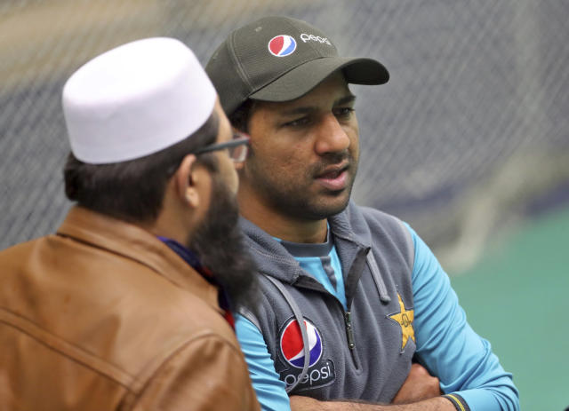 Pakistan cricket chief selector Inzamam-ul-Haq, left, listens to captain Sarfaraz Ahmed during a training session ahead of their Cricket World Cup match against India at Old Trafford in Manchester, England, Saturday, June 15, 2019. (AP Photo/Aijaz Rahi)
