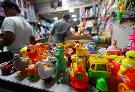 Toys are displayed inside a Chinese toy shop at a market in Kolkata