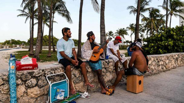 PHOTO: A group of men play music on the beach in Miami Beach, Fla., on July 28, 2020, amid the coronavirus pandemic. (Chandan Khanna/AFP via Getty Images)