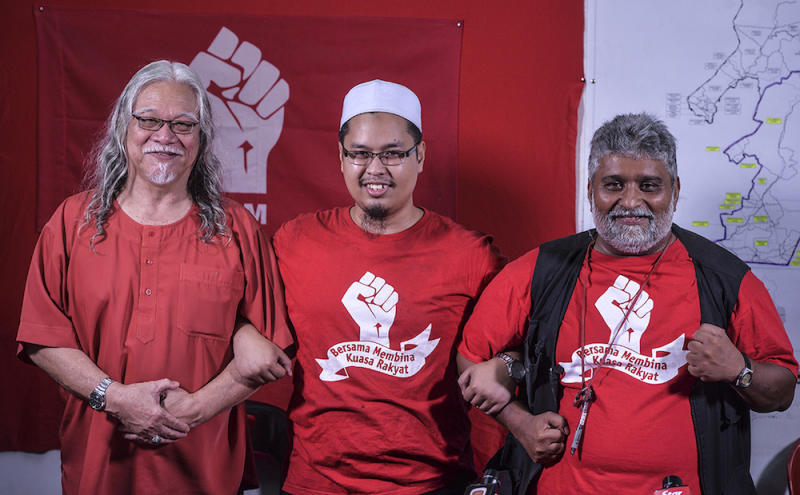 PSM president, Nasir Hashim, PSM candidate for Semenyih, Nik Aziz Afiq, and PSM party election director, S. Arutchelvan, smile during a press conference in Semenyih February 13, 2019. — Picture by Shafwan Zaidon