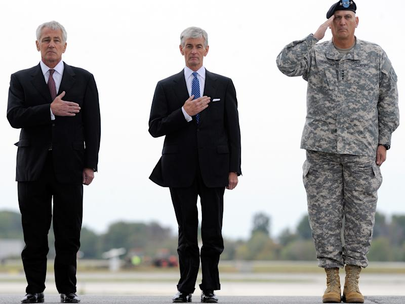 From left, Defense Secretary Chuck Hagel, Army Secretary John McHugh and Army Chief of Staff Gen. Raymond T. Odierno watch the remains of Pfc. Cody J. Patterson, not pictured, get carried off a military plane at Dover Air Force Base, Del. Wednesday, Oct. 9, 2013. According to the Department of Defense, Patterson, 24, of Philomath, Ore., died Oct. 6, 2013 in Zhari district, Afghanistan of injuries sustained when enemy forces attacked his unit with an improvised explosive device. (AP Photo/Steve Ruark)