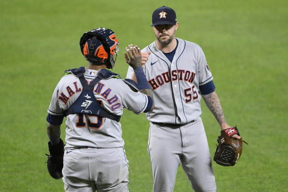 Houston Astros relief pitcher Ryan Pressly (55) and catcher Martin Maldonado (15) celebrate after a baseball game against the Baltimore Orioles, Tuesday, June 22, 2021, in Baltimore. (AP Photo/Nick Wass)