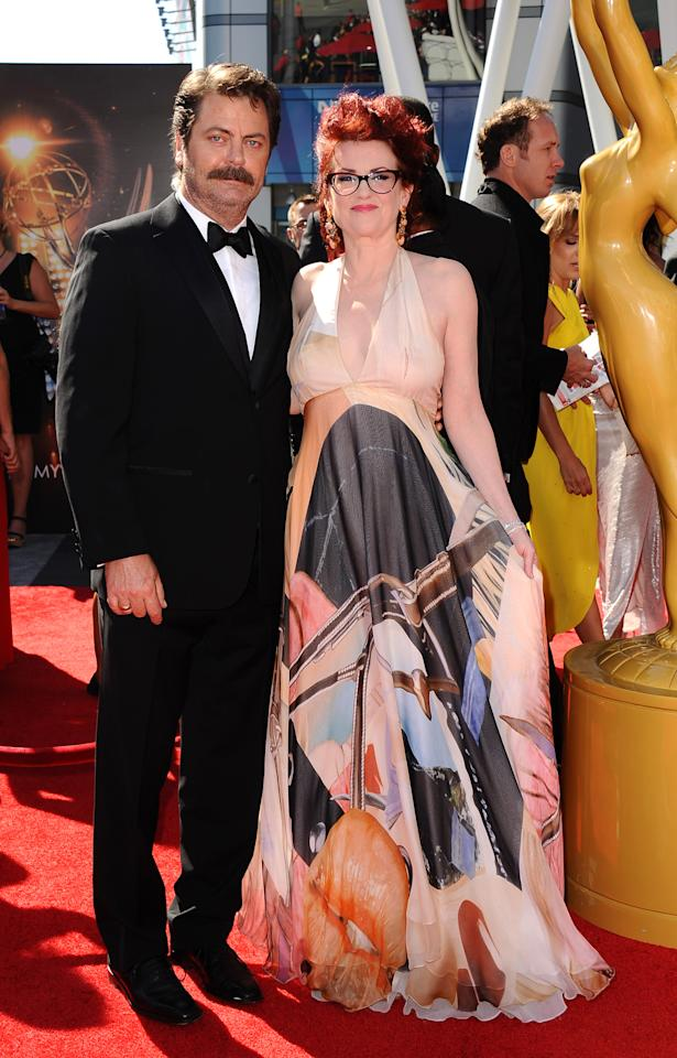 From left, Nick Offerman and Megan Mullally arrives at the 2013 Primetime Creative Arts Emmy Awards, on Sunday, September 15, 2013 at Nokia Theatre L.A. Live, in Los Angeles, Calif. (Photo by Scott Kirkland/Invision for Academy of Television Arts & Sciences/AP Images)