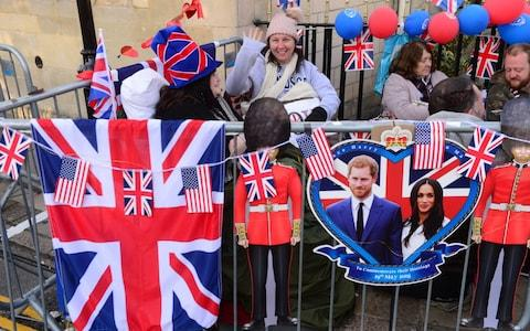 Royal fans awake at first light having spent the night outside of Windsor Castle - Credit: PAUL GROVER for The Telegraph