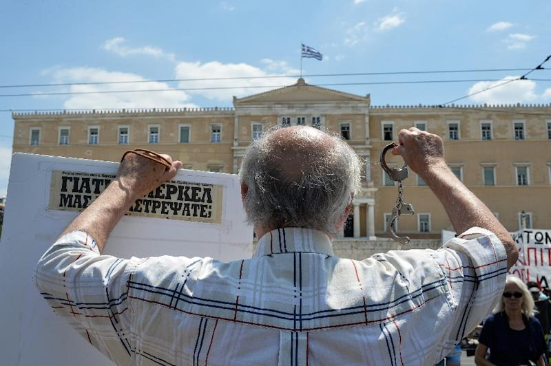 A protester shows handcuffs during a protest march in central Athens on July 15, 2015 against the new package of austerity measures (AFP Photo/Andreas Solaro)