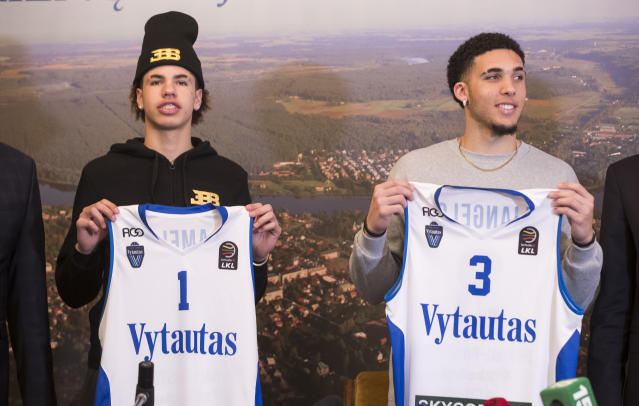 LiAngelo Ball, right, and his brother, LaMelo, display their jerseys after signing with Lithuanian team BC Vytautas. (AP)