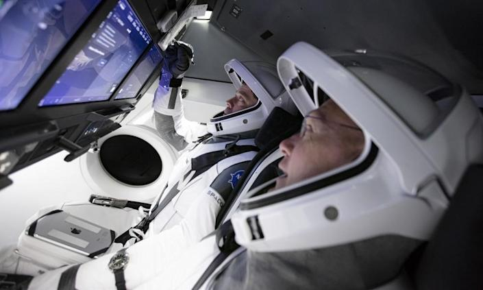 "<span class=""element-image__caption"">Doug Hurley, foreground, and Bob Behnken work in SpaceX's flight simulator at the Kennedy Space Center in Cape Canaveral, Florida.</span> <span class=""element-image__credit"">Photograph: AP</span>"