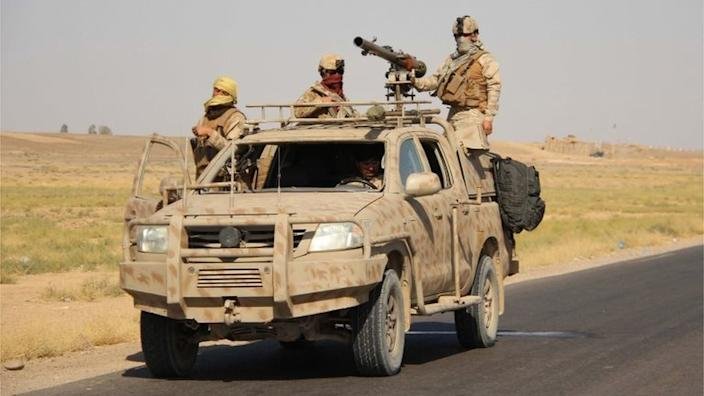 Afghan security officials patrol on Helmand-Kandahar highway after Taliban launched first large-scale attack on the capital of southwestern Helmand province in Afghanistan since the signing of a peace deal with the United States in late February, in Lashkargah, Helmand, Afghanistan, 13 October 2020.