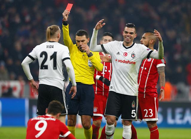 Soccer Football - Champions League Round of 16 First Leg - Bayern Munich vs Besiktas - Allianz Arena, Munich, Germany - February 20, 2018 Besiktas' Pepe reacts as Domagoj Vida is shown a red card by referee Ovidiu Hategan after a foul on Bayern Munich's Robert Lewandowski REUTERS/Michaela Rehle