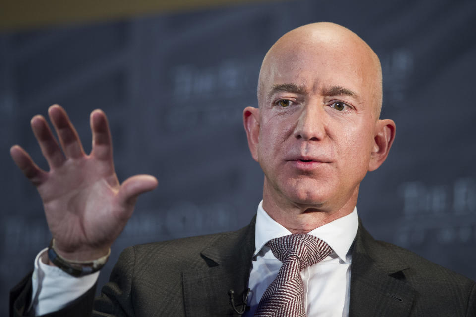 FILE- In this Sept. 13, 2018, file photo Jeff Bezos, Amazon founder and CEO, speaks at The Economic Club of Washington's Milestone Celebration in Washington. Bezos says the National Enquirer is threatening to publish nude photographs of him unless his private investigators back off the tabloid that detailed the billionaire's extramarital affair (AP Photo/Cliff Owen, File)