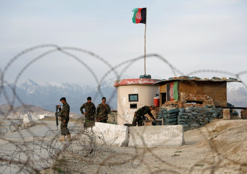 Afghan National Army (ANA) soldiers stand guard at a checkpoint outside Bagram prison, north of Kabul, Afghanistan