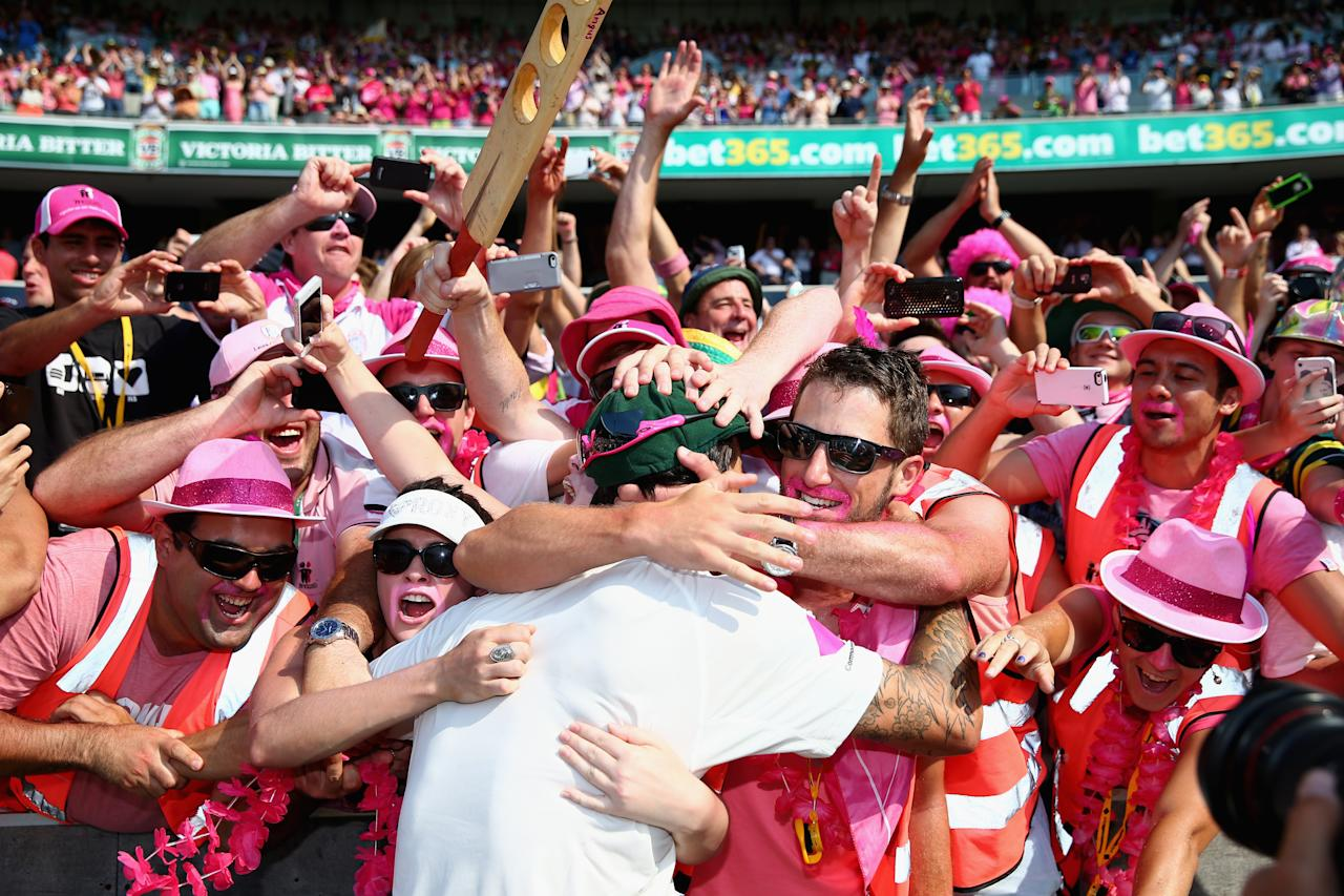 SYDNEY, AUSTRALIA - JANUARY 05:  Mitchell Johnson of Australia celebrates victory with fans during day three of the Fifth Ashes Test match between Australia and England at Sydney Cricket Ground on January 5, 2014 in Sydney, Australia.  (Photo by Ryan Pierse/Getty Images)