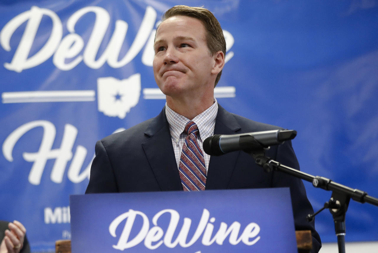 FILE - In this Nov. 30, 2017, file photo, Ohio Secretary of State Jon Husted, right, pauses as he speaks during a news conference at the University of Dayton in Dayton, Ohio. Husted, Ohio's elections chief wants Ohio counties to modernize their voting machines before the 2020 presidential election, and he's urging the governor and state lawmakers to foot much of the bill. (AP Photo/John Minchillo, File)
