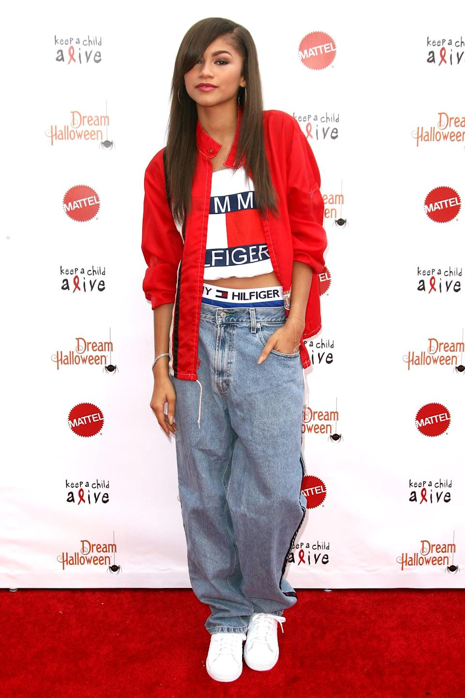 """<p><a class=""""link rapid-noclick-resp"""" href=""""https://www.popsugar.co.uk/Zendaya"""" rel=""""nofollow noopener"""" target=""""_blank"""" data-ylk=""""slk:Zendaya"""">Zendaya</a>'s been referencing for years. While attending a Keep a Child Alive event just before <a class=""""link rapid-noclick-resp"""" href=""""https://www.popsugar.co.uk/Halloween"""" rel=""""nofollow noopener"""" target=""""_blank"""" data-ylk=""""slk:Halloween"""">Halloween</a> in 2013, she wore a logo-heavy Tommy Hilfiger outfit nearly identical to the one worn by <a class=""""link rapid-noclick-resp"""" href=""""https://www.popsugar.co.uk/tag/Aaliyah"""" rel=""""nofollow noopener"""" target=""""_blank"""" data-ylk=""""slk:Aaliyah"""">Aaliyah</a> in her famous '90s campaign with the brand. Years later, Zendaya would go on to <a href=""""https://www.popsugar.com/fashion/Zendaya-x-Tommy-Hilfiger-Collection-Spring-2019-45385957"""" class=""""link rapid-noclick-resp"""" rel=""""nofollow noopener"""" target=""""_blank"""" data-ylk=""""slk:land her own collaboration with the brand"""">land her own collaboration with the brand</a>, designing two capsule collections which both came with extravagant runway shows.</p>"""
