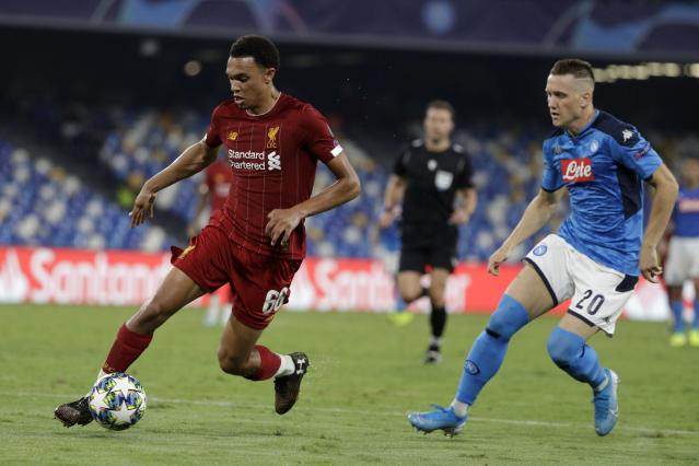 Liverpool's Trent Alexander-Arnold, left, controls the ball as Napoli's Piotr Zielinski looks on during the Champions League Group E soccer match between Napoli and Liverpool, at the San Paolo stadium in Naples, Italy, Tuesday, Sept. 17, 2019. (AP Photo/Gregorio Borgia)