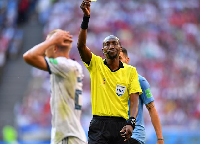 Soccer Football - World Cup - Group A - Uruguay vs Russia - Samara Arena, Samara, Russia - June 25, 2018 Russia's Igor Smolnikov is shown a second yellow card by referee Malang Diedhiou REUTERS/Dylan Martinez