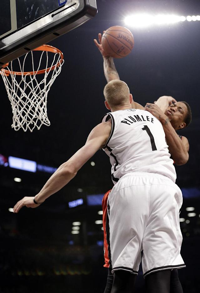 Brooklyn Nets' Mason Plumlee (1) fouls Toronto Raptors' DeMar DeRozan during the first half of Game 3 of an NBA basketball first-round playoff series Friday, April 25, 2014, in New York. (AP Photo/Frank Franklin II)