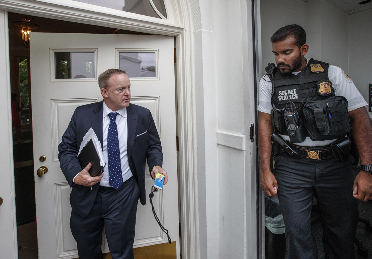 <p>Former White House press secretary Sean Spicer shows his ID to a Uniformed Secret Service officer as he enters the West Wing of the White House in Washington, Friday, Aug. 11, 2017, during renovations at the White House. (AP Photo/J. Scott Applewhite) </p>