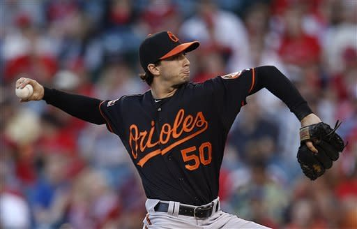 Baltimore Orioles relief pitcher Miguel Gonzalez throws against the Los Angeles Angels in the first inning of a baseball game in Anaheim, Calif., Friday, July 6, 2012. (AP Photo/Jae C. Hong)