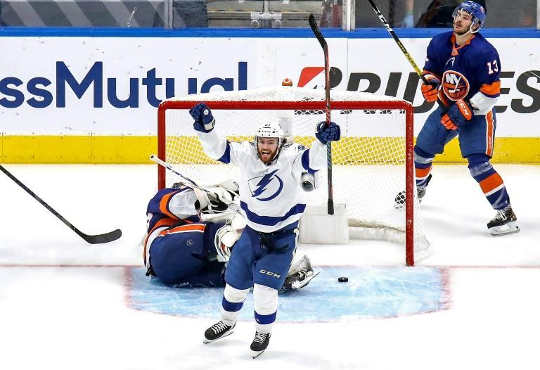 Tampa Bay Lightning foward Brayden Point celebrates after slipping the backcheck of Islanders Mathew Barzal (13) and scoring a goal to lift the Lightning to a 4-1 win in game four of their Eastern Conference playoff series in Edmonton, Canada