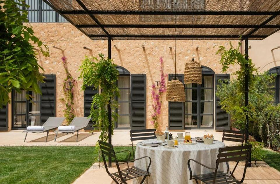 """<p>Located in the authentic Mallorcan town of Santanyi on the south east coast, <a href=""""https://go.redirectingat.com?id=127X1599956&url=https%3A%2F%2Fwww.booking.com%2Fhotel%2Fes%2Fcan-ferrereta.en-gb.html%3Faid%3D2070929%26label%3Dmallorca-hotels&sref=https%3A%2F%2Fwww.redonline.co.uk%2Ftravel%2Fg37570714%2Fmallorca-hotels%2F"""" rel=""""nofollow noopener"""" target=""""_blank"""" data-ylk=""""slk:Can Ferrereta"""" class=""""link rapid-noclick-resp"""">Can Ferrereta</a> is a new Mallorca hotel in a lesser-known part of the island. The Soldevila-Ferrer family have transformed the historic 17th century building into a stunning 32-room hotel surrounded by verdant gardens. The design is mindful of the history and tradition of the building, while the interiors are reminiscent of a grand summer house, featuring simple, light and airy design. </p><p>For the most luxurious stay, check into the signature Pool Suite, which has its own private sundeck, garden and pool. Restaurant OCRE, overseen by Chef Alvar Albaladejo, serves simple and seasonal Mediterranean fare, and restaurant and bar LA FRESCA sits by the 25-metre swimming pool as the perfect spot to relax. You can take the relaxation to the SA CALMA SPA, where innovative multi-sensory, Mediterranean-infused treatments await.</p><p><a class=""""link rapid-noclick-resp"""" href=""""https://go.redirectingat.com?id=127X1599956&url=https%3A%2F%2Fwww.booking.com%2Fhotel%2Fes%2Fcan-ferrereta.en-gb.html%3Faid%3D2070929%26label%3Dmallorca-hotels&sref=https%3A%2F%2Fwww.redonline.co.uk%2Ftravel%2Fg37570714%2Fmallorca-hotels%2F"""" rel=""""nofollow noopener"""" target=""""_blank"""" data-ylk=""""slk:CHECK AVAILABILITY"""">CHECK AVAILABILITY</a></p>"""