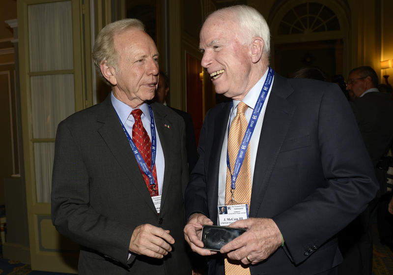 U.S. Senators John Mc Cain, right, and Joseph Lieberman take a break during a meeting on World Economy in Cernobbio, Italy, Friday, Sept. 7, 2012. Experts and leaders gathered in Italy to discuss the prolonged crisis in a structurally flawed Europe, political dysfunction pushing America off a 'fiscal cliff' and the emerging economies slowdown drying up the last engine of global growth. (AP Photo/Giuseppe Aresu)