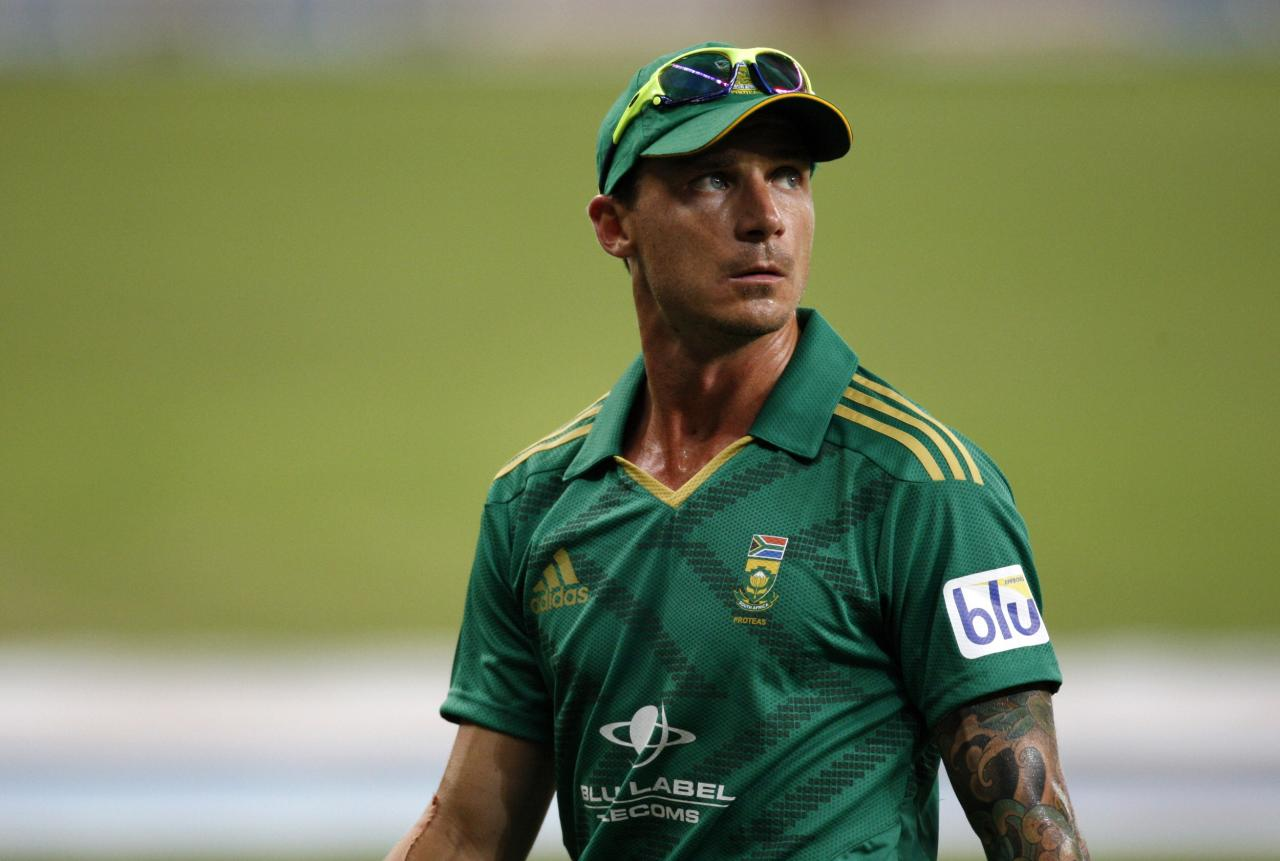 South Africa's Dale Steyn walks back after after taking three wickets during their first Twenty20 international cricket match against Pakistan in Dubai November 13, 2013. REUTERS/Nikhil Monteiro (UNITED ARAB EMIRATES - Tags: SPORT CRICKET)