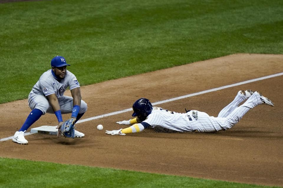 Milwaukee Brewers' Orlando Arcia slides safely into third with Kansas City Royals third baseman Maikel Franco covering during the eighth inning of a baseball game Saturday, Sept. 19, 2020, in Milwaukee. Arcia advanced from first on a wild pick off throw. (AP Photo/Morry Gash)