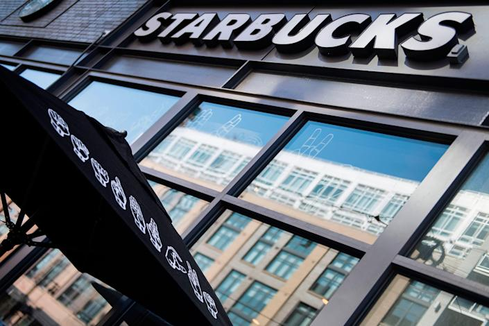 Starbucks will give all its US employees a pay raise of at least 10 per cent next month, the firm has confirmed (AFP via Getty Images)