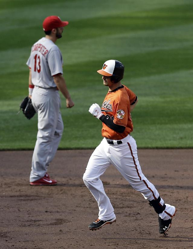 Baltimore Orioles' Caleb Joseph, right, rounds the bases past St. Louis Cardinals third baseman Matt Carpenter after hitting a two-run home run in the second inning of an interleague baseball game, Saturday, Aug. 9, 2014, in Baltimore. (AP Photo/Patrick Semansky)